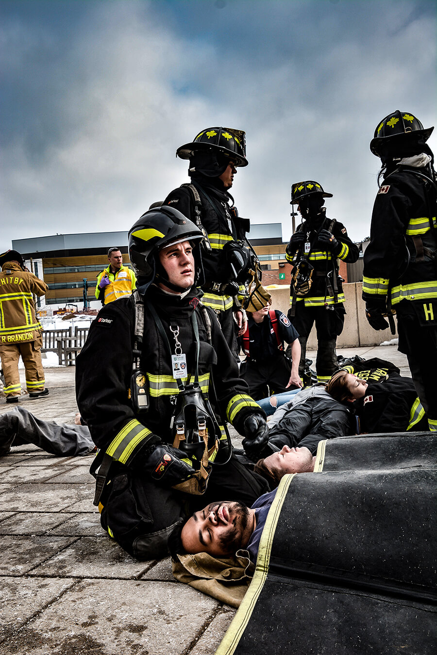 firefighter students simulation of helping injured beings