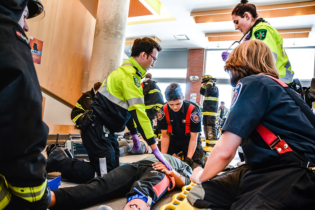 ems students simulation of helping injured beings