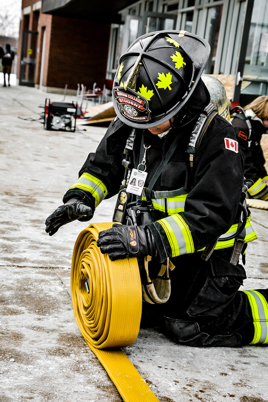 firefighter rolling hose